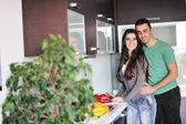"""Постер, картина, фотообои """"Young couple have fun in modern kitchen"""""""