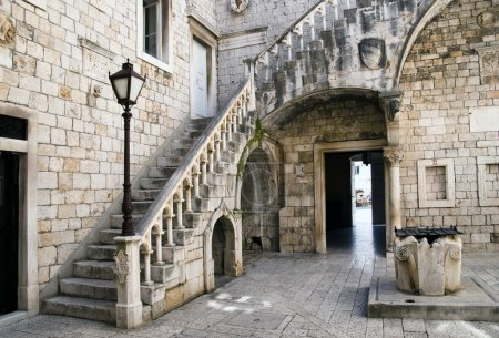 Photo for Old courtyard with a staircase and a well in Trogir Croatia - Royalty Free Image