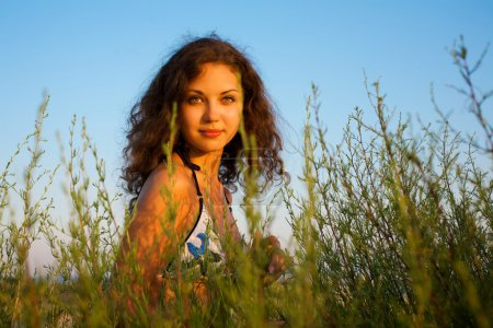 Photo for Portrait of a beautiful woman in grass - Royalty Free Image