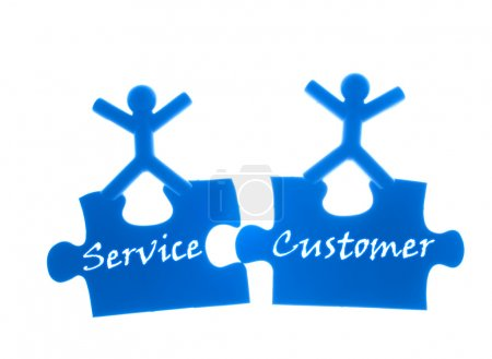 Photo for Right service to customer. Two rise hands and stand on top of puzzles. - Royalty Free Image