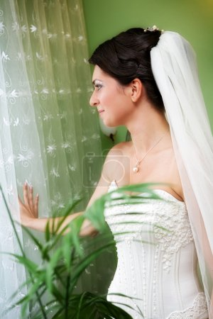 Photo for Portrait of beautiful young bride with wedding hairstyle close window - Royalty Free Image