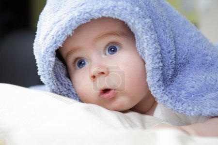 Photo for Cute baby looking out from under blanket - Royalty Free Image