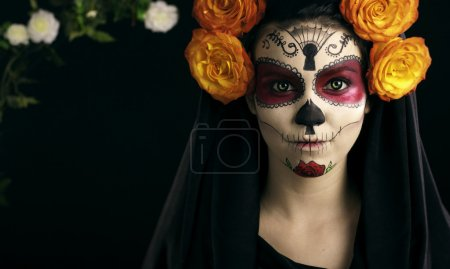 Creative face paint portrait flower .Day of the De...