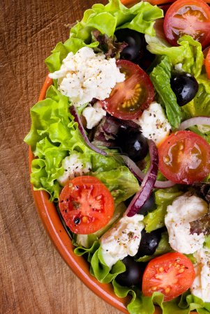 Photo for Greek salad with fresh vegetables and feta cheese - Royalty Free Image