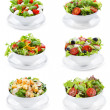 Set with different salads on white background...