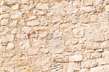 Photo pour Détail d'un mur de pierre avec une taille différente de la roche. - image libre de droit