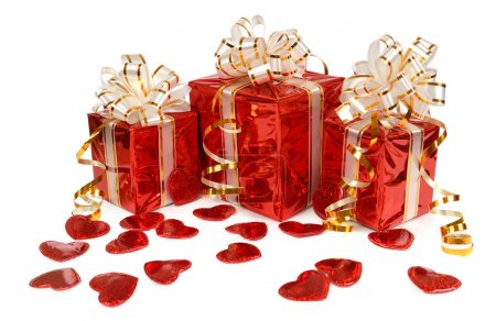 Three red gift box and hearts isolated on white background