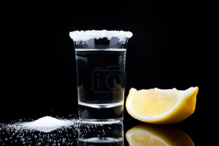 Photo for Tequila shot, with lemon and salt close up on black background - Royalty Free Image