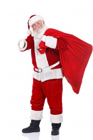 Photo for Real Santa Claus carrying big bag and showing ok, isolated on white background - Royalty Free Image