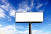 Blank advertising billboard on blue sky
