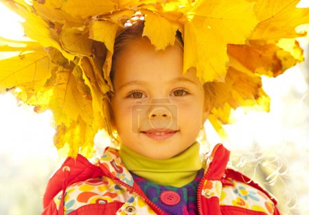 Child in autumn park.