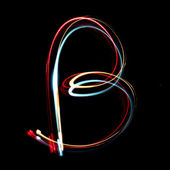 Letter b made from brightly coloured neon lights