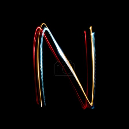 Letter N made from brightly coloured neon lights