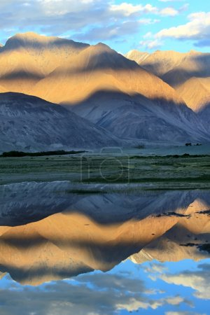 Mountains and reflection in water.Sunset. Himalayas
