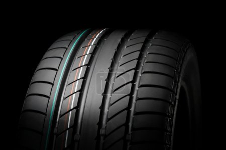 Photo for Close up of new sport summer tire, over black, studio shot - Royalty Free Image