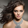 Studio portrait of young gorgeous brunette with ev...
