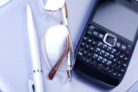 Glasses near mobile phone