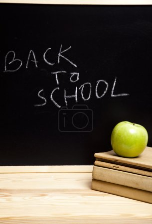 Back to schoo, inscription on blackboard