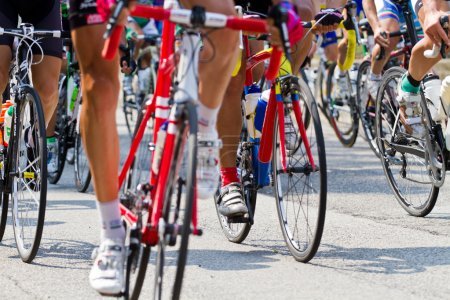 Photo for The cyclists riding by at the bicycle race - Royalty Free Image