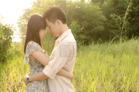 Photo for Romantic asian outdoor couple - Royalty Free Image