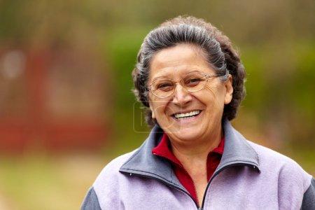 Cheerful senior lady outdoor