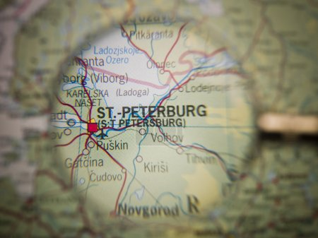 Photo for Magnifying Glass in front of a St Petersburg map - Royalty Free Image