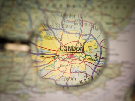 Photo for Magnifying Glass in front of a London map - Royalty Free Image
