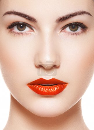 Cute model face with bright evening make-up, orange lipstick, purity skin