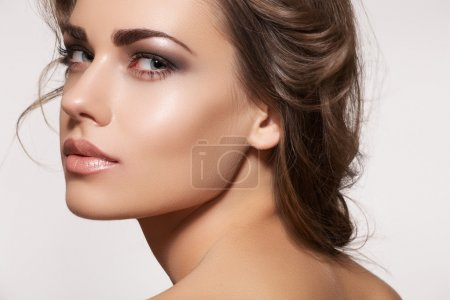 Photo for Glamour portrait of beautiful woman model with fresh daily make-up and romantic wavy hairstyle. Fashion shiny highlighter on skin. - Royalty Free Image