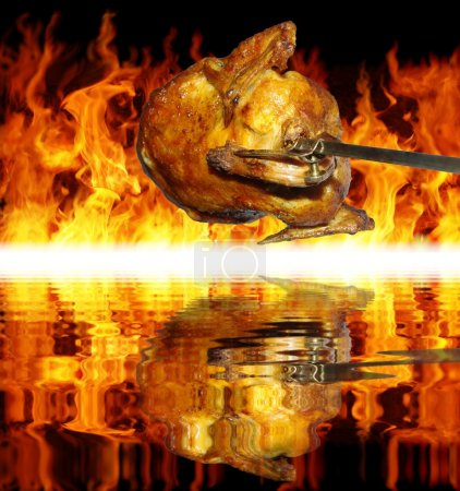 Chicken on grill on background of flames...