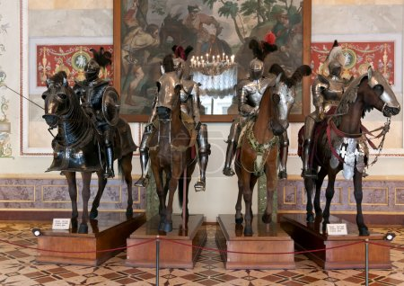 The exhibition in the Hermitage Museum, four horsemen in armor.