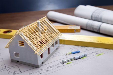 Photo for Construction plans and blueprints on wooden table - Royalty Free Image