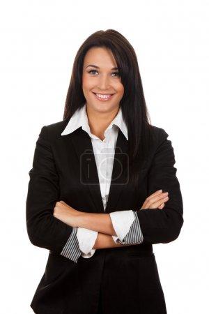 Photo pour Femme d'affaires souriante debout avec les mains pliées - image libre de droit