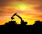 Digger shovel working at sunset