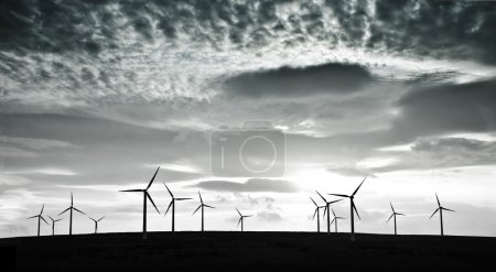 Wind turbines against dramatic clouds