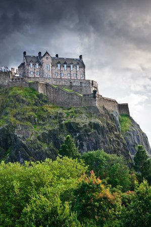 Photo for Edinburgh castle over dramatic clouds, Scotland, UK - Royalty Free Image