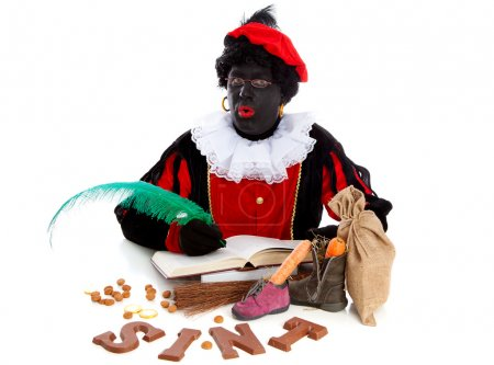 Photo for Zwarte piet ( black pete) typical Dutch character part of a traditional event celebrating the birthday of Sinterklaas in december over white background - Royalty Free Image