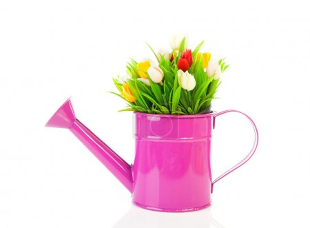 Pink watering can with plastic tulips