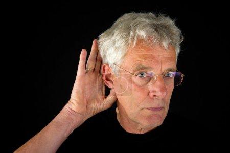 Listening elderly man