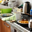 Pile of dirty dishes in the kitchen - Compulsive H...