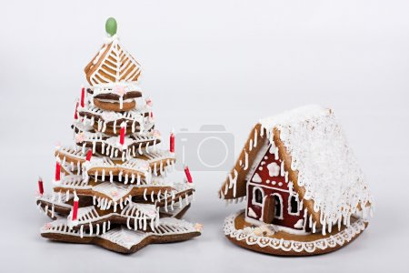 Gingerbread house with gingerbread tree