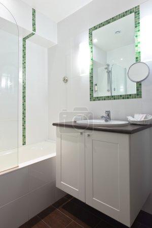 Hotel bathroom in white tones