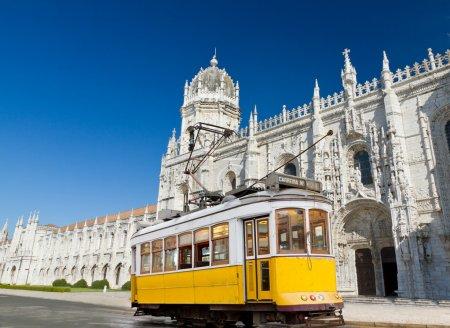 Yellow tram of Lisbon at Jeronimos monastery, Portugal