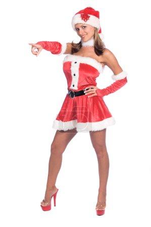 Photo pour Sexy Mme Père Noël pointant isolé sur blanc - image libre de droit