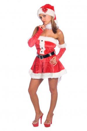Photo pour Aide blonde sexy du Père Noël debout avec son menton dans sa main - image libre de droit