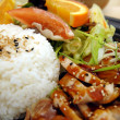 Chicken Teriyaki plate with chicken teriyaki, asian soy ginger salad, steamed rice and oranges