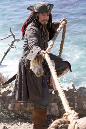 Pirate Captain making a hasty retreat uses a heavy...