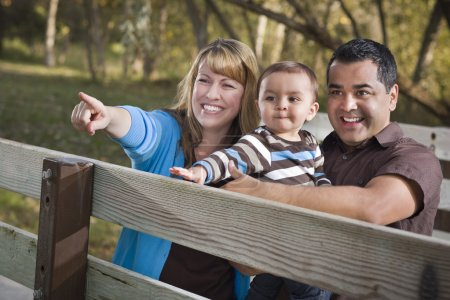 Photo for Happy Mixed Race Ethnic Family Having Fun Playing In The Park. - Royalty Free Image