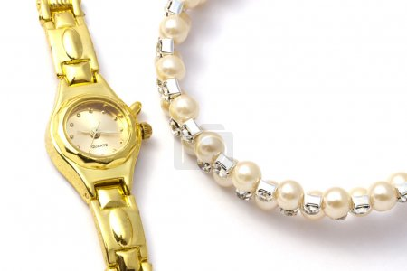 Photo for Golden wrist watch and necklace on white background - Royalty Free Image