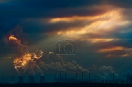 Urban scene. Rays of light in sunset sky